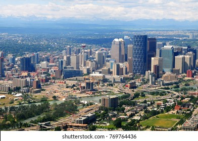 Aerial view of city of Calgary with Rocky Mountains in the background, Alberta, Canada