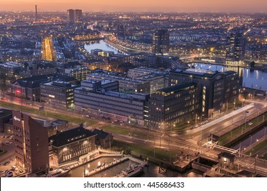 Aerial view of the city center of Rotterdam at dusk.
