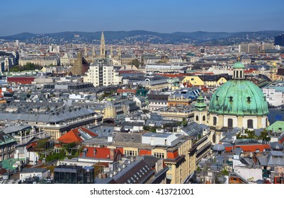 Aerial view of city center of Vienna with St.Peter church and town hall seen from St. Stephen's Cathedral in Austria