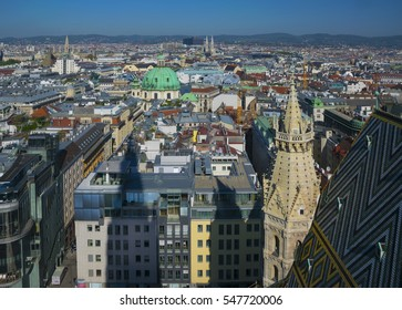 Aerial view of city center of Vienna with mosaic roof or St.Stephan Domkirche, Stephanplatz, St.Peter church and town hall seen from St. Stephen's Cathedral in Austria