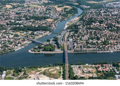 aerial view of the city of Conflans-Ainte-Honorine, confluent of the rivers Oise and Seine in the department of Yvelines in France