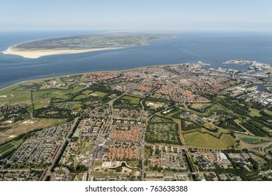 Aerial view of city Den Helder in Holland. In the back Wadden island Texel. The huge sandy beach is militairy terrain DE MOK. The Wadden are on the UNESCO world heritage list.