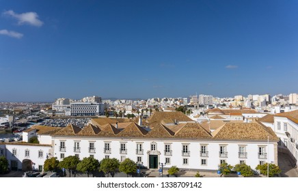 Aerial view of the city of Faro, Portugal showing rooftops the harbor and downtown