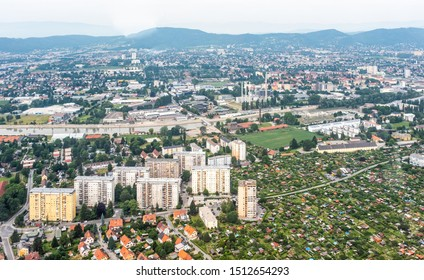 Aerial view of city Graz from helicopter drone with districts Jakomini and Gries and river Mur on a cloudy summer day in Austria, Europe