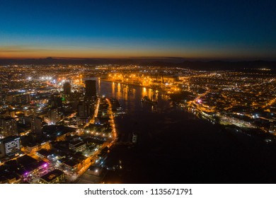 Aerial view of the City of Itajai (left) and the City of Navegantes (right) during dusk