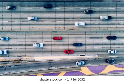 Aerial view of city landscape with autobahn motorway in metropolis, Bird's eye view. automobiles moving at street with modern automotive expressway. interchange road highway, junctions freeway