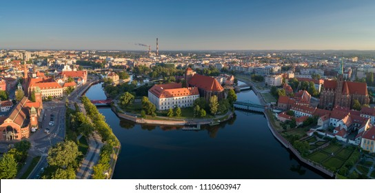 Aerial view of the city Sand (Piasek) Island and western part of the city of Wroclaw at morning. Beautiful panorama of the historical city by the river, popular travel destination for tourists - Shutterstock ID 1110603947