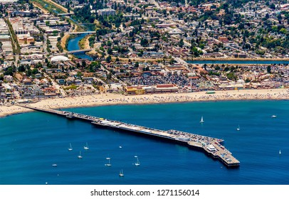 The aerial view of the city of Santa Cruz with its beach in Northern California on a sunny day.