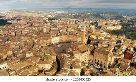 Aerial view of the city of Siena involving famous Piazza del Campo or Campo Square. Tuscany, Italy