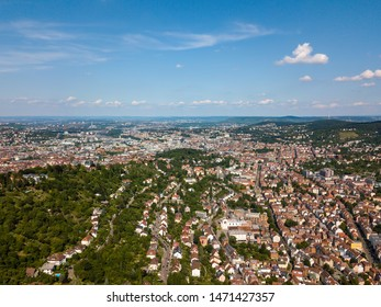 Aerial view of the city of Stuttgart as seen from the south with the main station, city centre and the football stadium in the background.