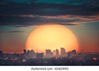 Aerial view of city sunset with big orange sun in Kiev, Ukraine