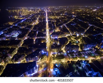 Aerial view of city Thessaloniki at night, Greece.. Image taken with action drone camera causing distortion and blur.