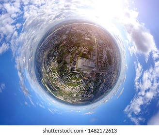 Aerial view of the city with traffic, streets and buildings with green trees and rails under the blue sky with clouds at summer day in Novosibirsk. Panoramic 360 degrees of the panet.