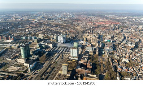 Aerial view of the city of Utrecht with the construction site at the central station and the shopping mall HOOG CATHARIJNE in the front. There is a clear horizon with a blue sky.