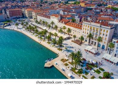 Aerial view of cityscape of Croatian city Split behind Riva promenade