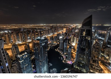Aerial view of cityscape at night in Dubai.UAE