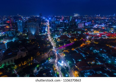 Aerial View of Cityscape at Night with Vibrant Lights Surabaya, East Java, Indonesia, Asia