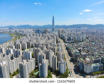 Aerial view cityscape of Seoul, South Korea. Aerial View Lotte tower at Jamsil.  View of Seoul with river and mountain. Seoul downtown city skyline, Aerial view of Seoul, South Korea, 08/20.2018