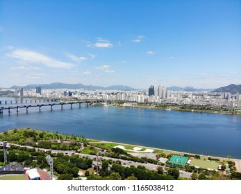 Aerial view cityscape of Seoul, South Korea. Drone View of Seoul with river and mountain. Seoul downtown city skyline, Aerial view of Seoul, South Korea, 08/20.2018