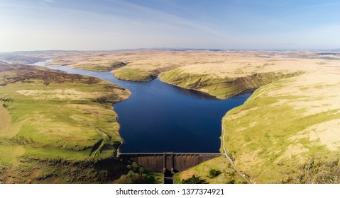 Aerial view of Claerwen Reservoir and dam, in the Elan Valley, mid Wales, Spring 2019