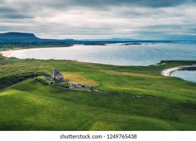 Aerial view of Classiebawn Castle built on the Mullaghmore peninsula in County Sligo, Ireland, with North Atlantic ocean in the background