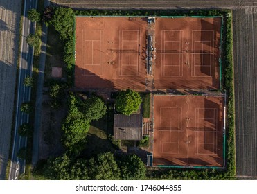 Aerial view of clay tennis court.