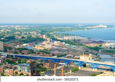 Aerial view of Cleveland Ohio looking west over the industrial Flats and Lake Erie shoreline