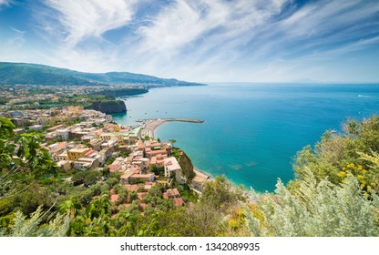 Aerial view of cliff coastline Meta di Sorrento and Gulf of Naples in Italy. Sunny summer day with blue sky, clear sea and green mountains of Sorrento Peninsula.