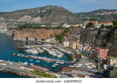 Aerial view of the cliff and the port of Piano di Sorrento, with the Lattari mountains in the background