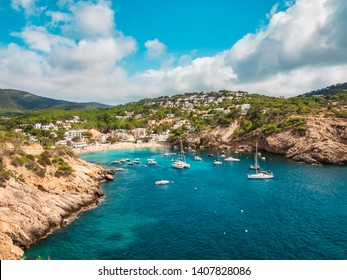 Aerial view of the cliffs and the beach of Cala Vadella, Ibiza, Spain.beach where summer families with children
