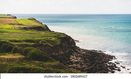 Aerial view from the cliffs of the English Channel. Green grass, azure water, clear blue sky. Idyllic seascape. Cap Gris Nez, Pas-de-Calais, France. Travel destinations, vacations concepts