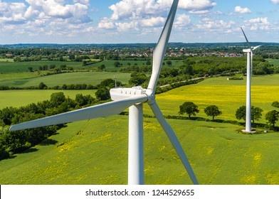 Aerial view and closeup of a wind turbine