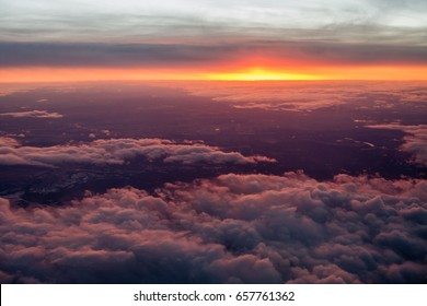 Aerial view of clouds and colorful sunrise for use as background or texture