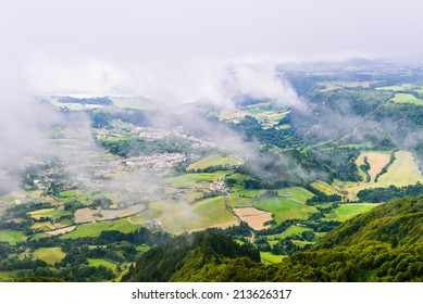 Aerial view with clouds to the Furnas city and valley, Sao Miguel island, Azores