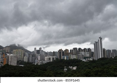 an aerial view of a cloudy and rainy day of the overpopulated Hong Kong city skyline