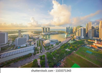 Aerial view of cloudy sunrise at Marina Bay Singapore city skyline