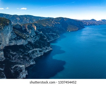 An Aerial View Of the coast of Baunei,Ogliastra,Blu water,mediterranean vegetation and Rocky Mountains
