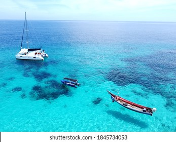 Aerial view of coast beach, yacht ship, green blue sea - Koh Hey island, Phuket province, Thailand.