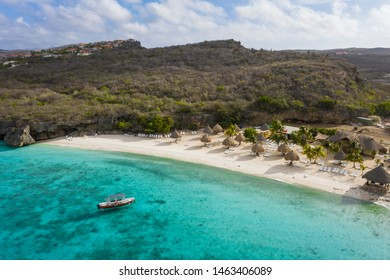 Aerial view of coast of Curaçao in the  Caribbean Sea with turquoise water, white sandy beach and beautiful coral reef at Playa Cas Abao
