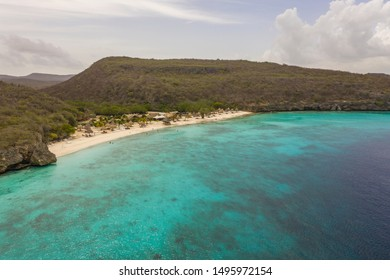 Aerial view of coast of Curaçao in the Caribbean Sea with turquoise water, cliff, beach and beautiful coral reef around Playa Cas Abao