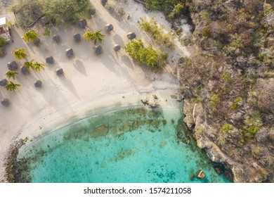 Aerial view of coast of Curaçao in the Caribbean Sea with turquoise water, cliff, beach and beautiful coral reef around Playa Daaibooi