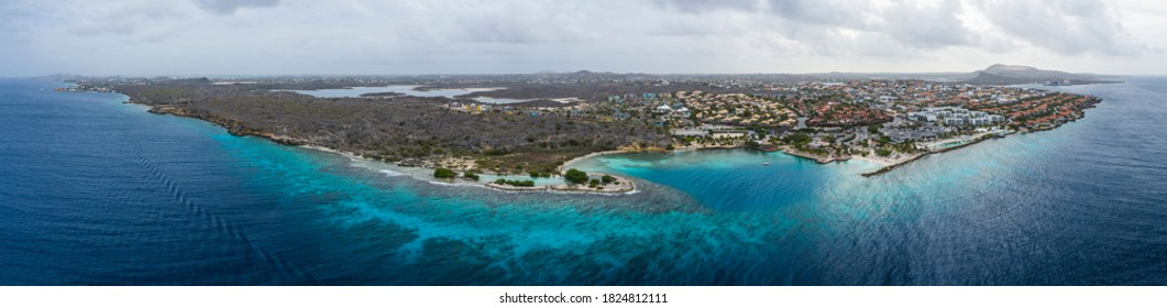Aerial view of coast of Curaçao in the Caribbean Sea with turquoise water, cliff, beach and beautiful coral reef