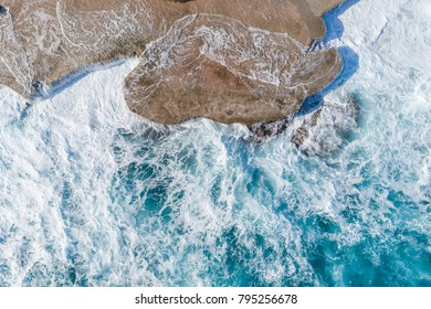 Aerial view of the coast of Montenegro. Storm waves on the Ploсe beach.
