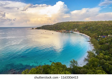An Aerial view of a coastal bay in Koh Rong Island, Cambodia during the sunrise.