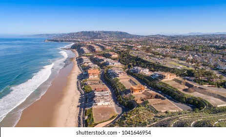 Aerial view of coastal neighborhood at the beach in California with some homes under construction.