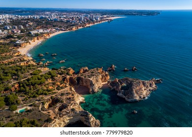 Aerial view of the coastline with beautiful beaches along the city of Portimao in Algarve, Portugal