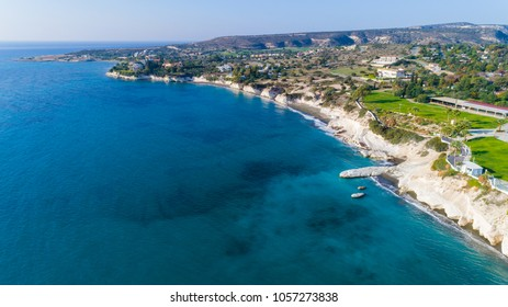 Aerial view of coastline and landmark big white chalk rock at Governor's beach, Limassol, Cyprus.The steep stone cliffs and deep blue sea waves crushing in coves at Kalymnos fish restaurant from above