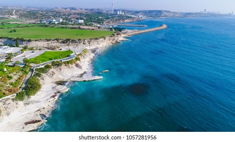 Aerial view of coastline and landmark big white chalk rock at Governor's beach,Limassol, Cyprus. Steep stone cliffs and deep blue sea waves next to Kalymnos fish restaurant and vasilikos power station
