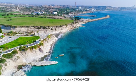 Aerial view of coastline and landmark big white chalk rock at Governor's beach,Limassol, Cyprus. Steep stone cliffs and deep blue sea waves next to Kalymnos fish restaurant and vasilikos power station
