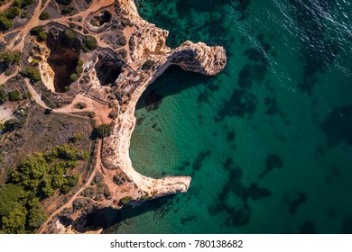 Aerial view of the coastline in the Praia do Alemao in Portimao, Algarve, Portugal; Concept for travel in Portugal and Algarve